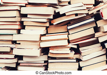 old books in the flea market - piles of old books in the...