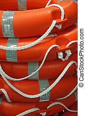 piles of Orange life preserver for help to people in danger of drowning