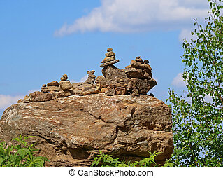Piles of rocks with blue sky in the background