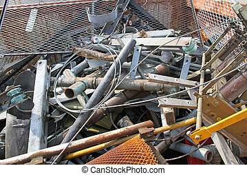 piles of scrap iron with broken and rusted objects in a...