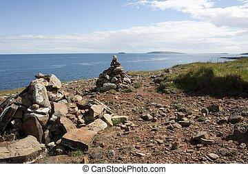 Piles of stone on a coast