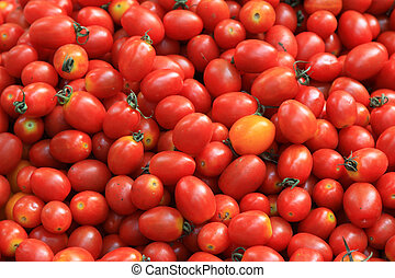 Piles of tomatoes in a market