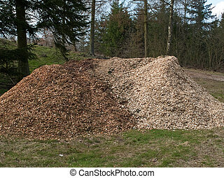 Piles of wood chips mulch for gardening