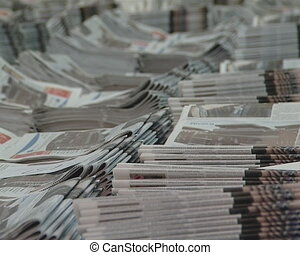 piles printed newspaper