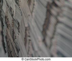 piles printed newspapers