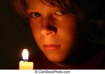 Pilgrim - a boy in the glow of candlelight