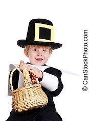 Pilgrim bearing gifts - Young boy dressed as a pilgrim...