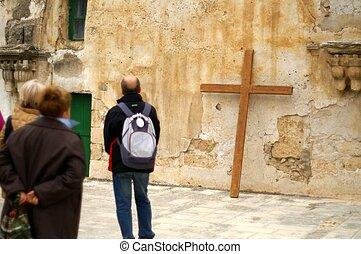 pilgrim with a cross in jerusalem