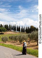 pilgrimage - pilgrim on her way in tuscany italy