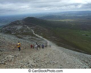 pilgrims descending Croagh Patrick mountain in county Mayo Ireland sacred to Saint Patrick
