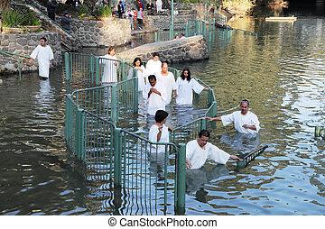 Pilgrims enter the water