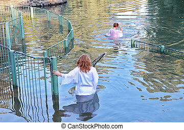 Pilgrims in the water - Yardenit, Israel - January 21: ...