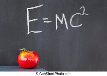 pilha livros, com, um, maçã vermelha, e, um, quadro-negro,...