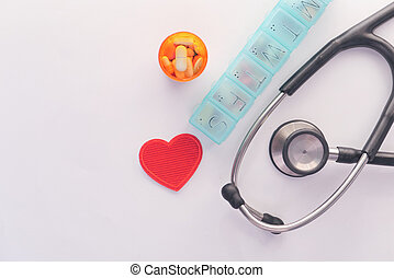 pill box and container stethoscope on white background