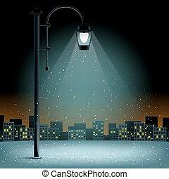 pillar light and snow falls night city