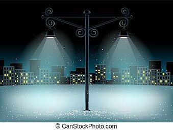 pillar lights on night snow city