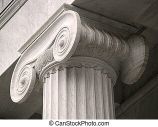 A stark gray column that is masterfully crafted exhibits the beauty and workmanship that has gone into creating it.