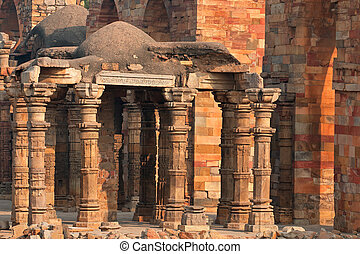 Pillars at the Qutb Minar complex - Old sandstone pillars at...