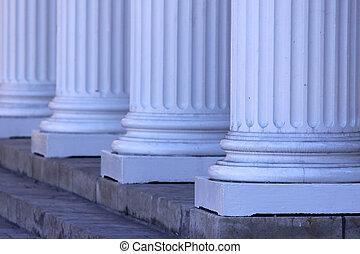 Close up shot of four big pillars in a row