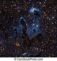 The Pillars of Creation. Infrared view of the Eagle Nebula or M16. It is a young open cluster of stars in the constellation Serpens. Retouched colored image. Elements of this image furnished by NASA.