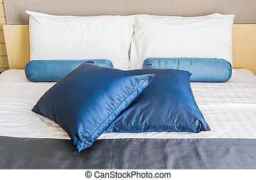 Pillow on double bed.