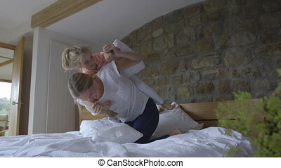 Pillowfight! - Mother and daughter having a pillowfight on...