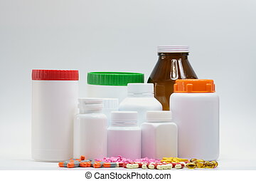 Pills and bottles with cap on white background