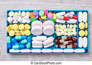 Pills and capsules in container.