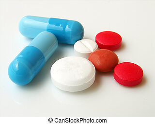 Pills and capsules - mixed pills on white background