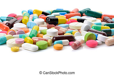 pills and capsules on white background, macro