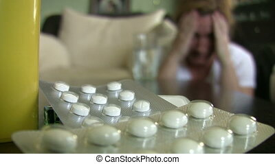 Pills and depression - Woman under stress.