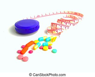 pills and diet tape on white background