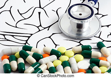 Pills and stethoscope lying on brain graphic