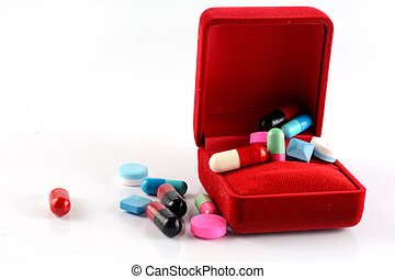 pills capsule in red gift box
