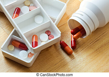 Pills, capsules and tablets sorted in pillbox