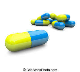 Close-up of some blue and yellow capsule pills