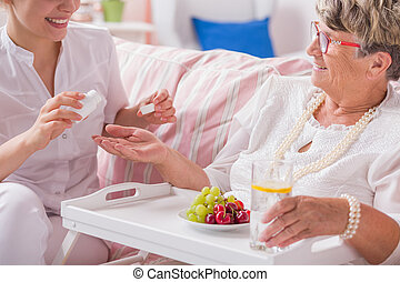 Pills for daily therapy - Smiled nurse preparing the dose of...