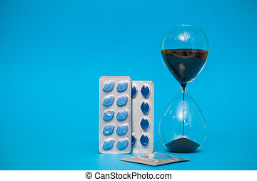 Pills for sexual male health on a blue background