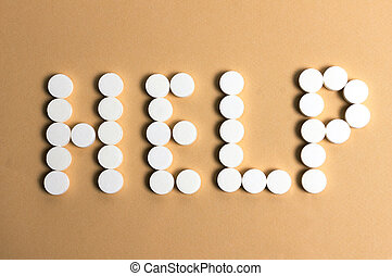 """pills forming the word """"HELP"""""""