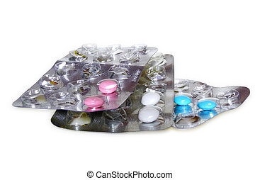 Pink, white and blue pills in blister pack on white background