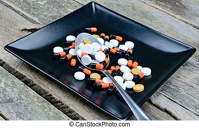 pills in dish on table