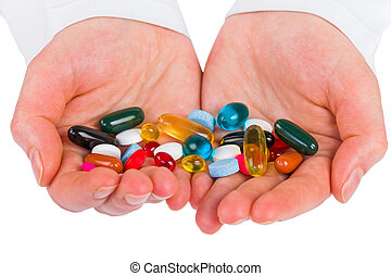 Pills in hands - Closeup photo of colorful pills in hands