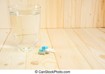pills medicine and water glass, ready to eat.
