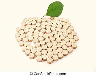 Pills medicine in shape apple with green leaf bio