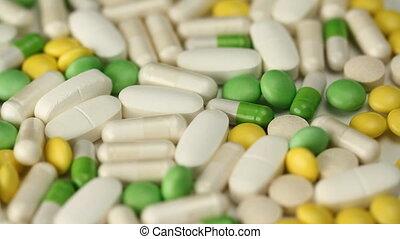 Pills. Medium shot. - A variety of tablets, pills and...