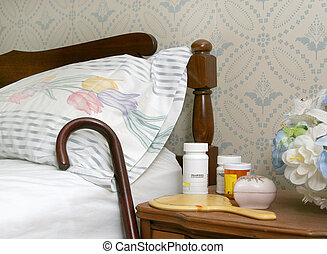 pills on a bedside table - medicine bottles and a cane...