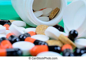 pills on green table