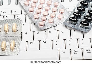 Pills on keyboard