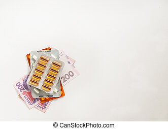 pills on money on a white background, concept