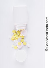 Pills on white background, top view.